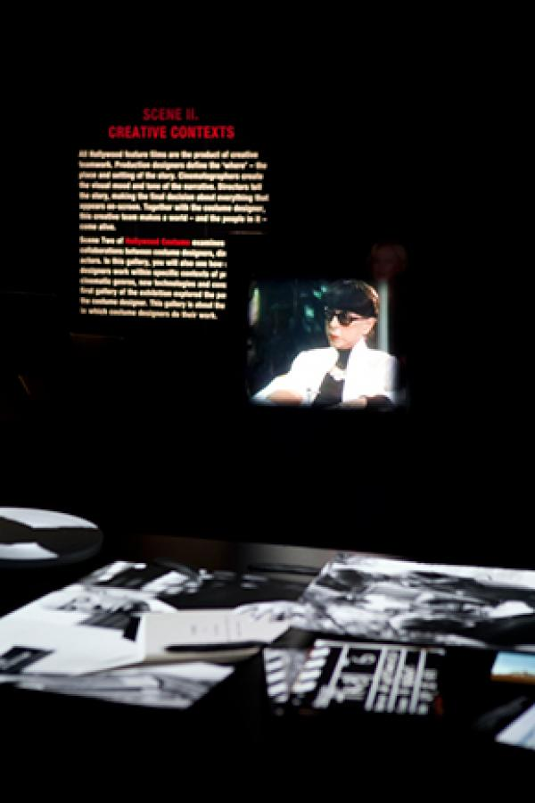 Media projection of costume designer Edith Head.