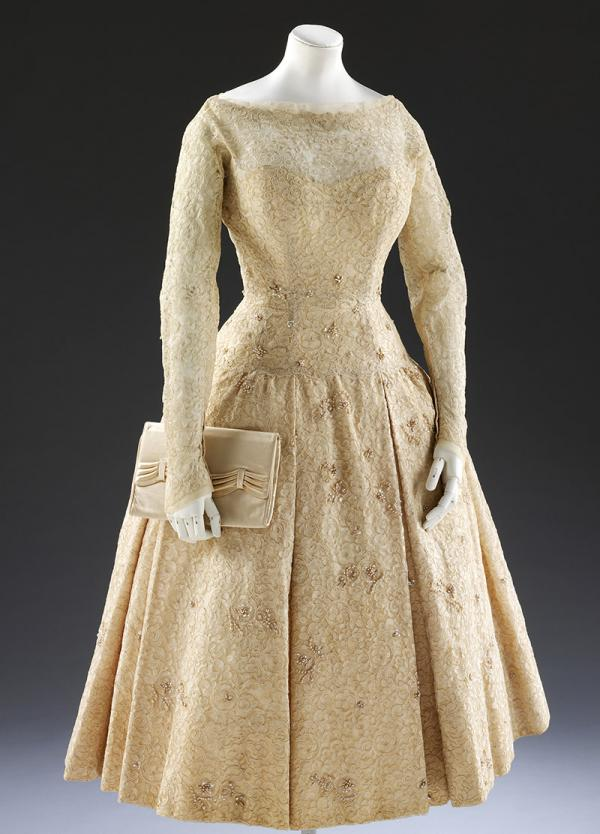 Norman Hartnell dress, with matching satin clutch bag, designed for Laurel Heath's wedding in 1957. © Victoria and Albert Museum, London