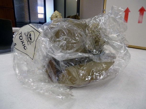 T.112-1939, poke bonnet, enclosed in a plastic bag due to its toxicity