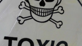 Skull-and-crossbones toxicity warning sign on V&A hats which are thought to have unacceptable levels of mercury in them