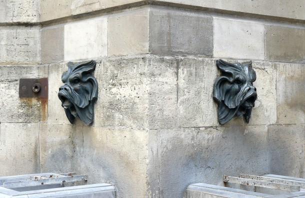 Two mascarons on the Fontaine des Quatre-Saisons, Paris. Photograph uploaded to Wikipedia by Siren-Com