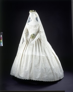 White satin wedding dress trimmed with Honiton lace, 1865