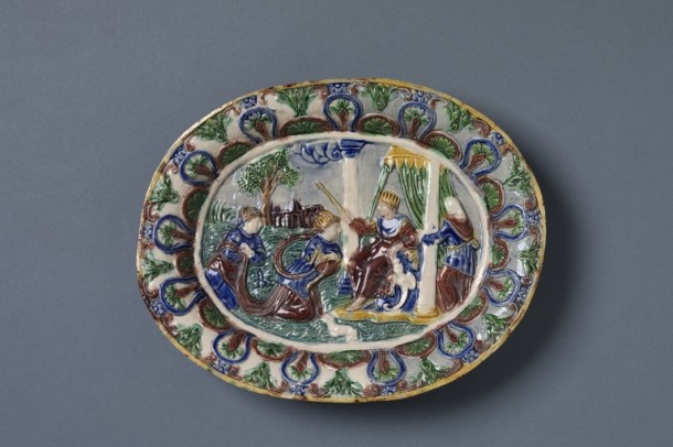Buff earthenware with moulded decoration in low relief and decorated with coloured glazes. Depicitng the Old Testament story of Queen Esther before King Ahasuerus, French, about 1600. V&A 1795-1855
