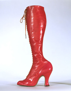 T.321-1970 Left boot from a pair of ladies' red leather, calf-length, laced boots with cotton twill, plain woven silk, metal and shoe string; retailed by National Shoe Stores, London; made in Belgium; retailed in London; c.1920.