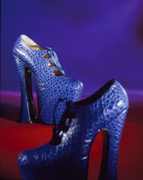 T.225:1-1993; T.225:2-1993 Pair of bright blue punched leather Mock-Croc platform shoes, blue silk ribbon laces, platform soles by Vivienne Westwood (b.1941); U.K. (London); from the Autumn/ Winter 1993 - 94 Anglomania Collection.