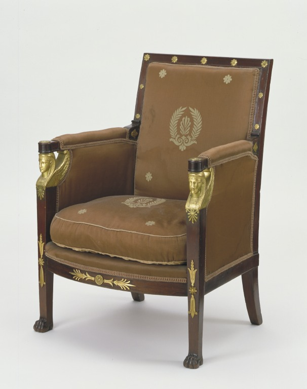 This armchair was part of a set of seat furniture made for the French  hero, Maréchal Ney (1769-1815). Ney was one of the Emperor  Napoleon's military leaders, and he came to be known in France as  'the bravest of the brave'. In 1805, after his marriage, Napoleon helped  him to buy a house in Paris, the Hôtel de Saisseval. Ney furnished it  lavishly in the fashionable Empire style. He used many of the firms  who worked in the imperial palaces. The firm of Jacob-Desmalter,  which made these chairs, was the best-known supplier of luxury  furniture.