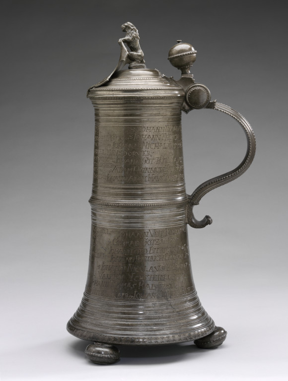 9086-1863 Tankard Pewter Guild tankard with inscriptions and lid with shield and lion figure. German, 1704. Joseph Dor Germany 1704 Pewter with engraved inscriptions.