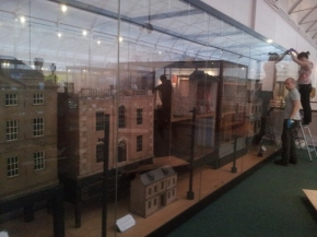 All the houses in the large display case in MoC's dolls' house gallery.