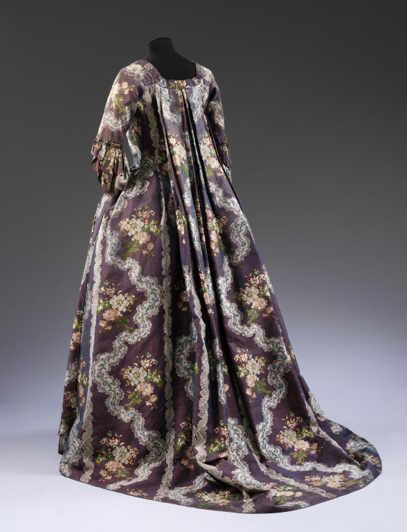 Sack back gown, purple silk, brocaded with flowers and lace, French, 1765-1770. V&A T.708-1913