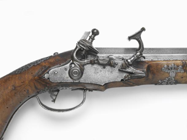 A detail of the gun's lock mechanism.