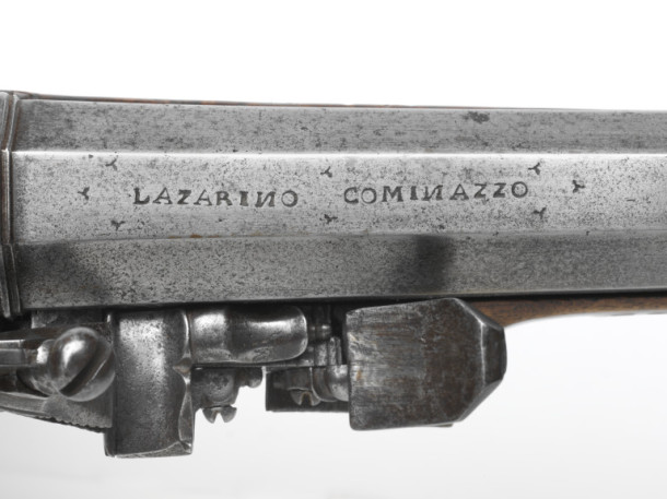 The maker's signature (Lazarino Cominazzo) engraved on the barrel of a mid-17th century carbine gun. V&A M.620-1927