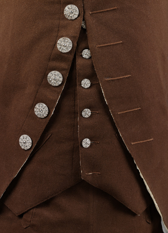 Raw edges on the front of the coat and waistcoat. The hint of white you can see is the silk lining.