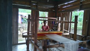Woman on the frame loom