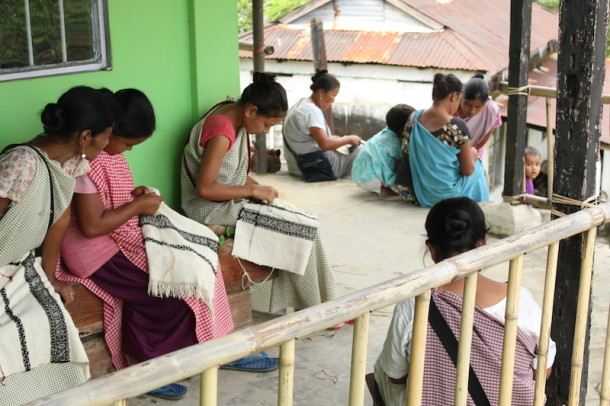 Women being trained in embroidery process