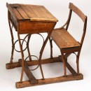 Copyright Victoria and Albert Museum. Child's desk and seat of stained and varnished woodings, on a wooden stand; made in the United Kingdom, ca. 1900-15. Museum No. MISC.537-1986