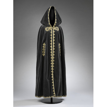 Black velvet cape with metal thread and silk embroidery, designed by Naima Bennis, c. 1970. V&A: ME.4-2015