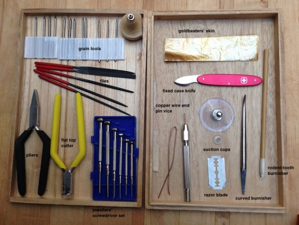 A selection of tools including two types of burnisher; pliers; suction cups; razor blade; flat top cutters; files; grain tools; goldbeaters' skin and jewellers screwdrivers