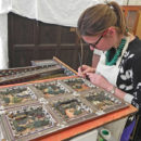 Furniture conservator Dana Melchar retouching a resin restoration