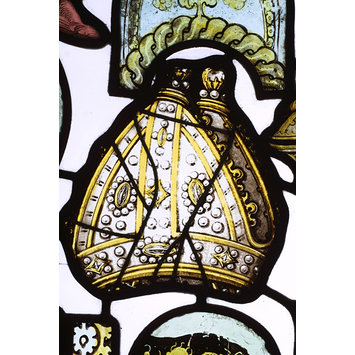 Glass fragment depicting a jewelled bishop's mitre, a 'mitre pretiosa', England, mid 15th century. Museum Number: C.386-1915 @ Victoria and Albert Museum, London