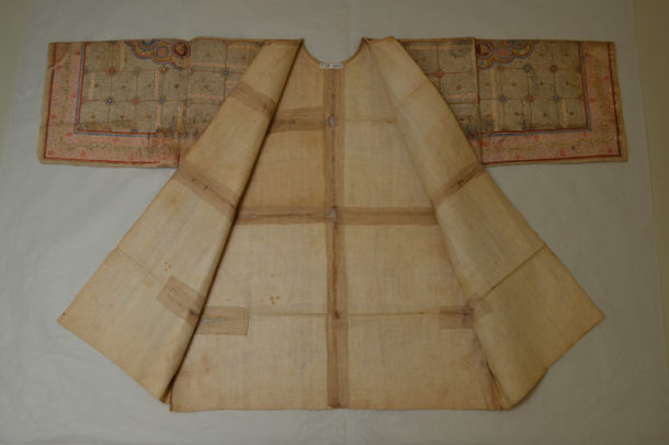Reverse of shirt showing old stitched repairs to support areas of damage