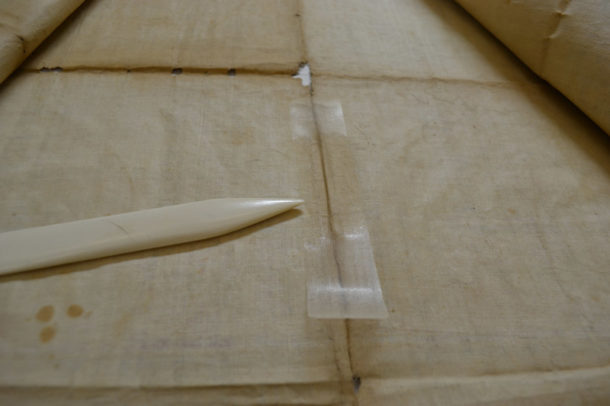 During application of crepeline and Klucel™ G adhesive film, the adhesive in the centre of the patch has been reactivated