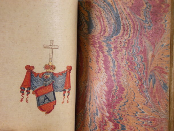 Inside the album. A coat of arms and a page of marbled paper.