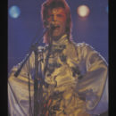 Colour print poster depicting David Bowie during his Ziggy Stardust period, 1974 (V&A S.3679-1995)