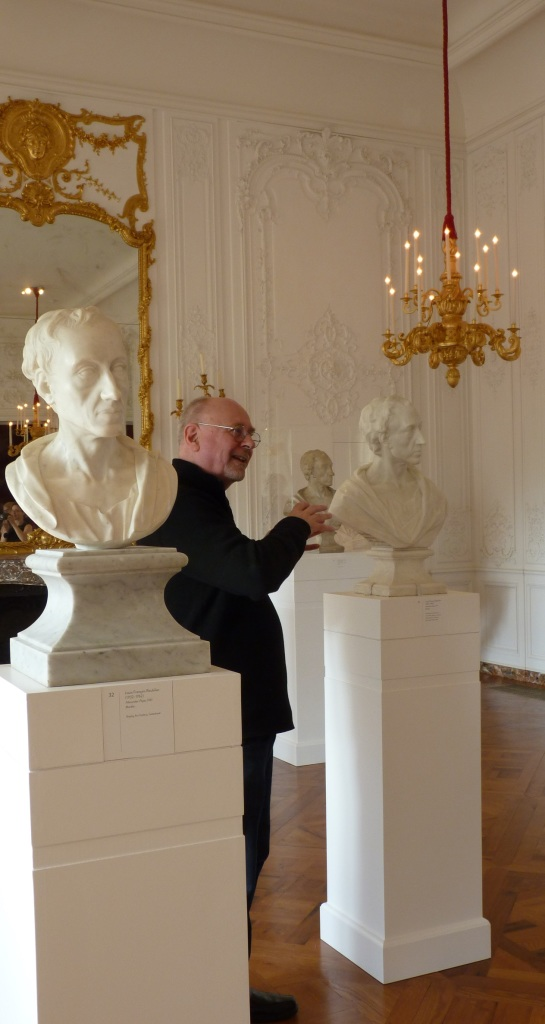 Malcolm Baker discussing Roubiliac's eight busts of Alexander Pope. Photograh by Katherine Elliott, 2014