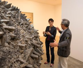 Mr Chun and Rosalie Kim discussing his art work