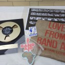 Items from the collection, l-r: gold disc, commemorative lp, contact sheet, AAA pass & grain sack