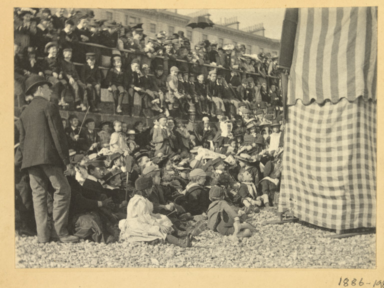A Punch and Judy show at Ilfracombe, photograph by Martin Paul, 1894. Museum no. 1886-1980. © Victoria and Albert Museum
