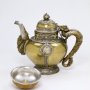 Teapot, 19th century, made in Ladakh, N W India. Silver gilt, silver and brass gilt, with inset turquoise.  Silver gilt, silver and brass gilt, with inset turquoise IM.112-1927