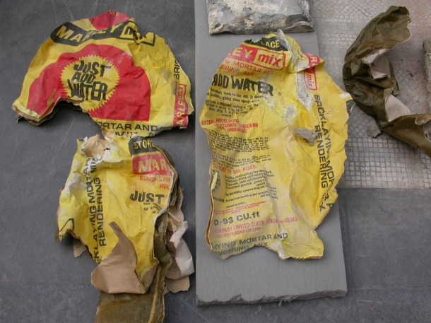 A shredded bag of bricklayers mortar and rendering mix found inside the Finch Monument