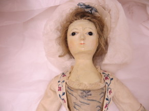 Doll in her box at Blyth House (C) Victoria and Albert Museum, London