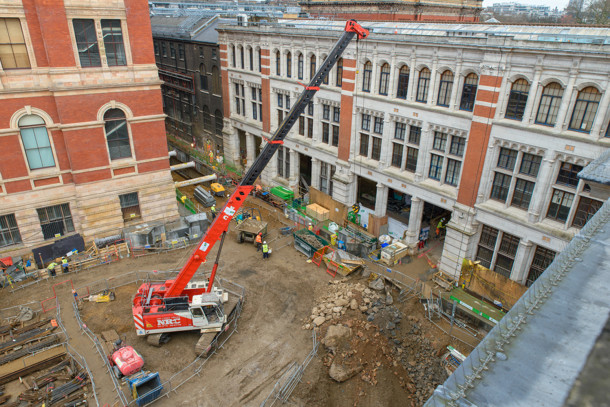 Current construction progress on the Exhibition Road Project site - all disused buildings have been demolished, piling works are complete, and excavation and propping of the site is underway. The three openings in the Western Range (building in the background) will provide a new entrance and lobby for the museum, 2015. © Victoria and Albert Museum, London