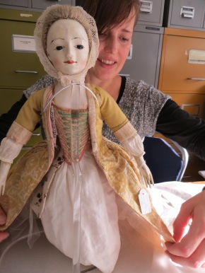 Christina putting finishing touches to dolls. (c) Victoria & Albert Museum