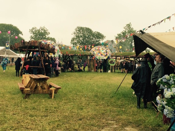 Festival-goers sheltering from the rain on Friday