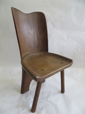 A carved chair with unusual solid back, from W.42-1922. (C) Victoria and Albert Museum, London