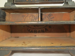 Cigar box stamp inside dressing mirror, part of W.42-1922. (C) Victoria & Albert Museum, London