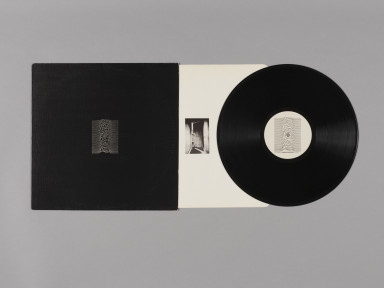 """Unknown Pleasures, debut album by Joy Division, record sleeve, printed inner and 12"""" vinyl record, 1979. Museum no. E.2275-1990 © Victoria and Albert Museum, London"""