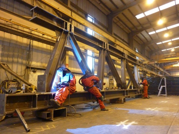 Welders from Bourne Steel working on a section of one of the 13 Trusses