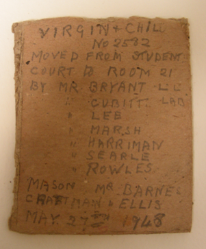 Note found inside the Misericordia relief with names of the people who last installed the object © Johanna Puisto, Victoria and Albert Museum, London.
