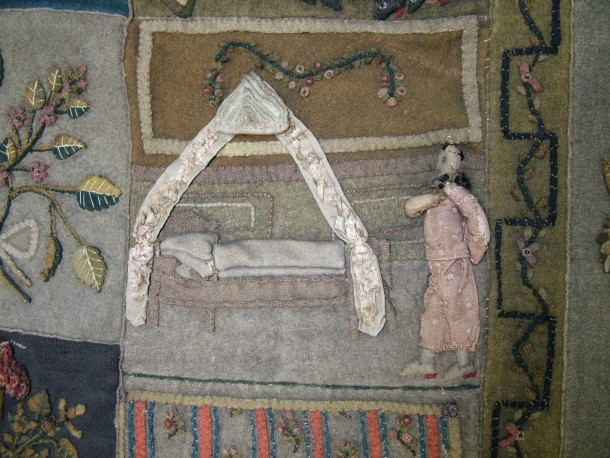 The heavily soiled Bohemian wool quilt. A man in a spotty banyan prepares to get into his silk-curtained bed © Victoria and Albert Museum, London