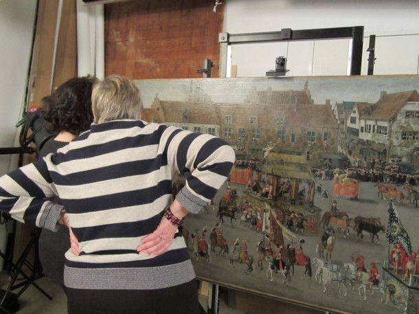 One of the Curators and Assistant Educator discussing which detail shots should be taken of the rather large and busy 'Ommegang' painting.  © Victoria and Albert Museum, London