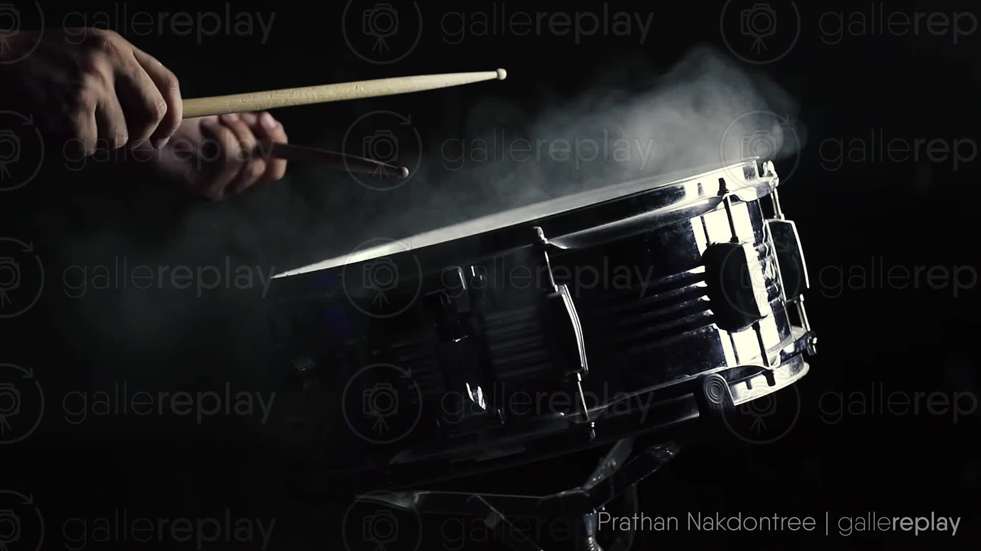 gallereplay | Close-Up of Drumstick and Snare Drum on Black Background