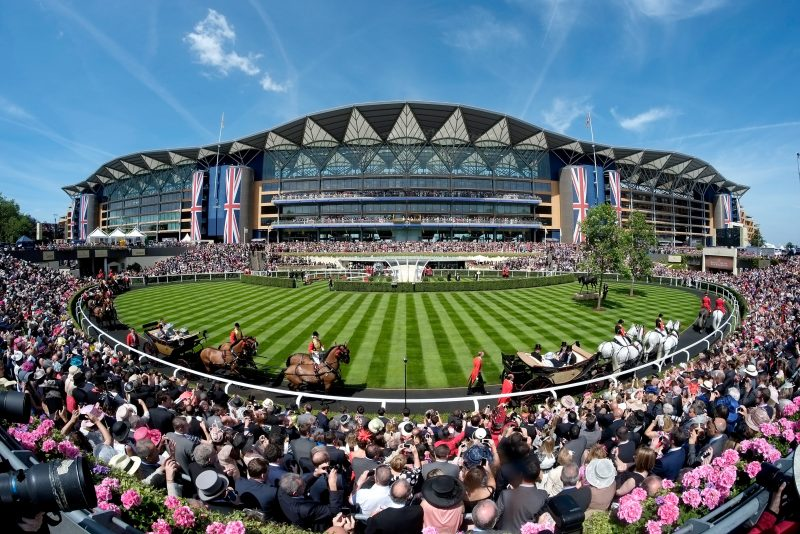 ASCOT, ENGLAND - JUNE 17: A general view of the Grandstand and Parade Ring during the Royal Procession on day one of Royal Ascot at Ascot Racecourse on June 17, 2014 in Ascot, England. (Photo by Alan Crowhurst/Getty Images for Ascot Racecourse)