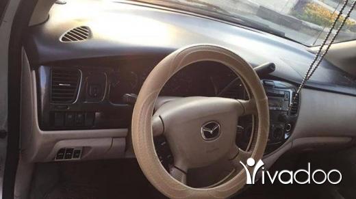 Mazda in Mina - Mazda model 2003