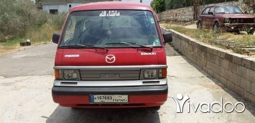 Vans in Port of Beirut - Mazda E 2000