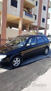 Mazda in Aldibbiyeh - Mazda 323f model 2002 in excellent condition