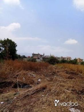 Apartments in Akkar el-Atika - أرض في ببنين منطقة الحريق مسيجة للبيع مساحة ٥٤٠متر